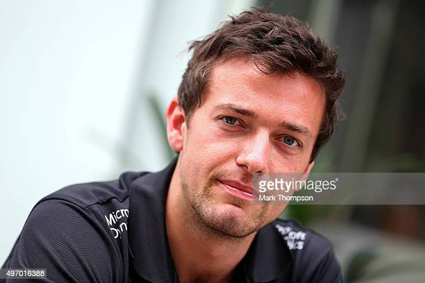 Jolyon Palmer of Great Britain and Lotus speaks with a member of the media in the paddock after practice for the Formula One Grand Prix of Brazil at...