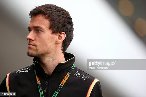 Jolyon Palmer of Great Britain and Lotus walks int he paddock during practice for the Formula One Grand Prix of Japan at Suzuka Circuit on September...