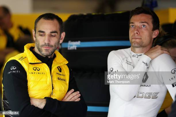 Jolyon Palmer of Great Britain and Renault Sport F1 and Renault Sport F1 Managing Director Cyril Abiteboul in the garage during practice for the...