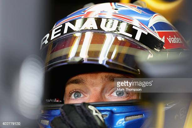 Jolyon Palmer of Great Britain and Renault Sport F1 sits in his car in the garage during final practice for the Formula One Grand Prix of Brazil at...