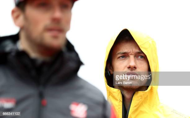Jolyon Palmer of Great Britain and Renault Sport F1 walks behind Romain Grosjean of France and Haas F1 on the drivers parade before the Formula One...