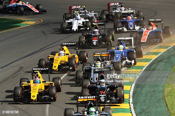 Jolyon Palmer of Great Britain drives the Renault Sport Formula One Team Renault RS16 Renault RE16 turbo with Fernando Alonso of Spain drives the...