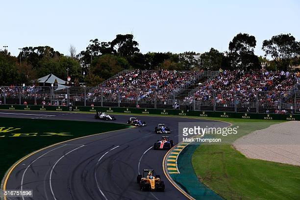 Jolyon Palmer of Great Britain drives the Renault Sport Formula One Team Renault RS16 Renault RE16 turbo on track ahead of Pascal Wehrlein of Germany...