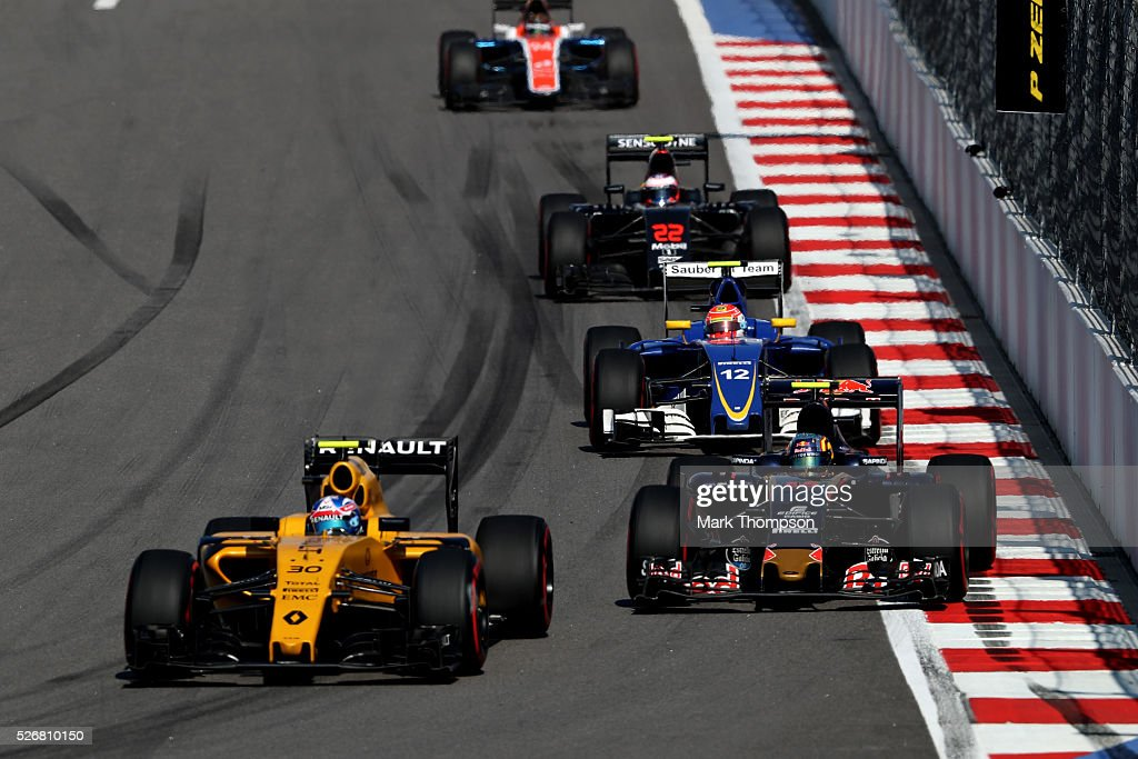 <a gi-track='captionPersonalityLinkClicked' href=/galleries/search?phrase=Jolyon+Palmer&family=editorial&specificpeople=7493068 ng-click='$event.stopPropagation()'>Jolyon Palmer</a> of Great Britain driving the (30) Renault Sport Formula One Team Renault RS16 Renault RE16 turbo ahead of Carlos Sainz of Spain driving the (55) Scuderia Toro Rosso STR11 Ferrari 060/5 turbo on track during the Formula One Grand Prix of Russia at Sochi Autodrom on May 1, 2016 in Sochi, Russia.