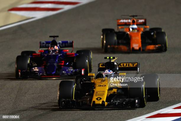 Jolyon Palmer of Great Britain driving the Renault Sport Formula One Team Renault RS17 leads Daniil Kvyat of Russia driving the Scuderia Toro Rosso...