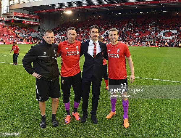 Jon Achterberg Danny Ward Brad Jones and Simon Mignolet of Liverpool pose at the end of the Barclays Premier League match between Liverpool and...