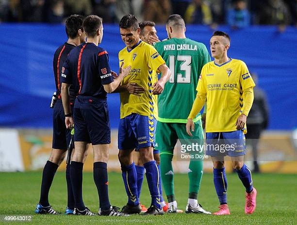 Jon Ander Garrido and Salvi of Cadiz react after the Copa del Rey Round of 32 First Leg match between Cadiz and Real Madrid at Ramon de Carranza...