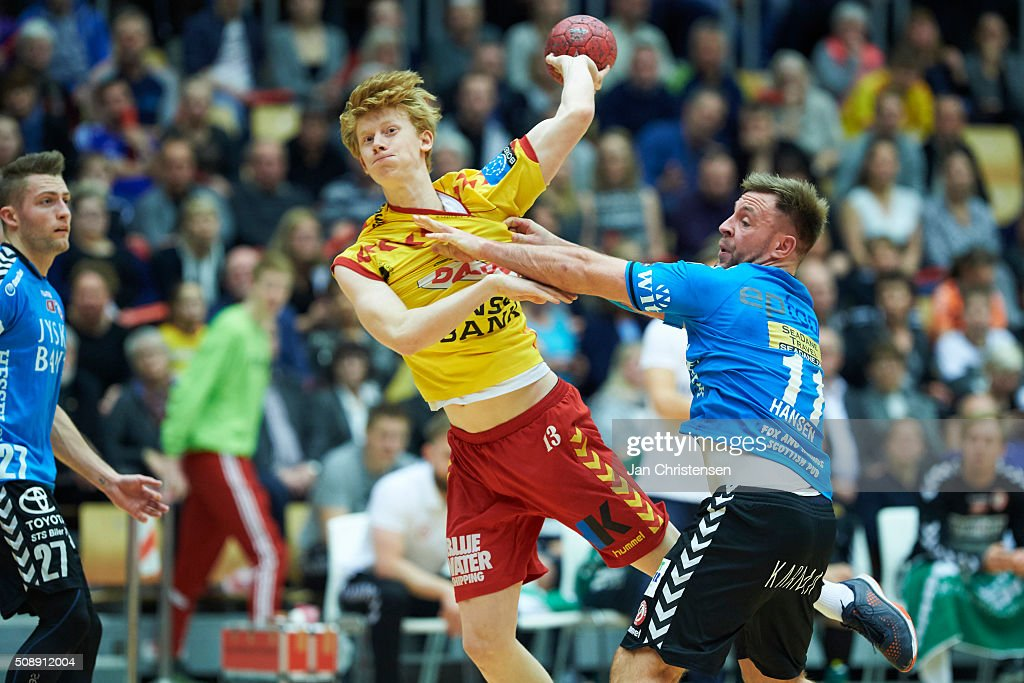 Jon Andersen of GOG Handbold challenge for the ball during the Santander Cup Final4 - Final between HC Midtjylland and GOG Handball in Sparekassen Fyn Arena on February 07, 2016 in Odense, Denmark.