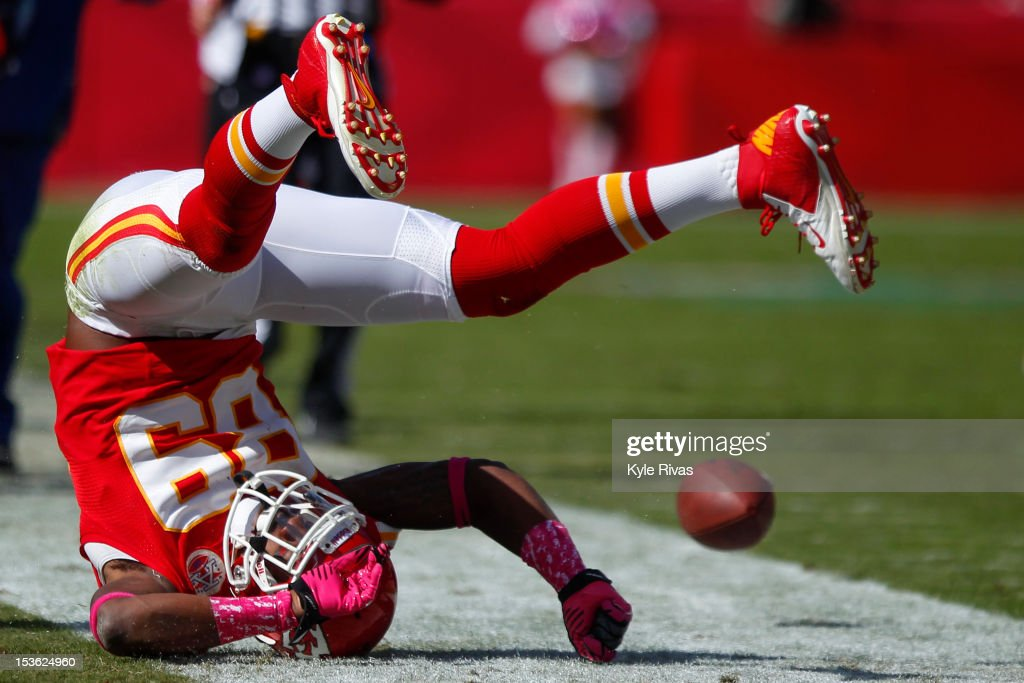 Jon Baldwin #89 of the Kansas City Chiefs flips over after having a pass knocked away by Jimmy Smith #22 of the Baltimore Ravens early in the fourth quarter on October 07, 2012 at Arrowhead Stadium in Kansas City, Missouri.