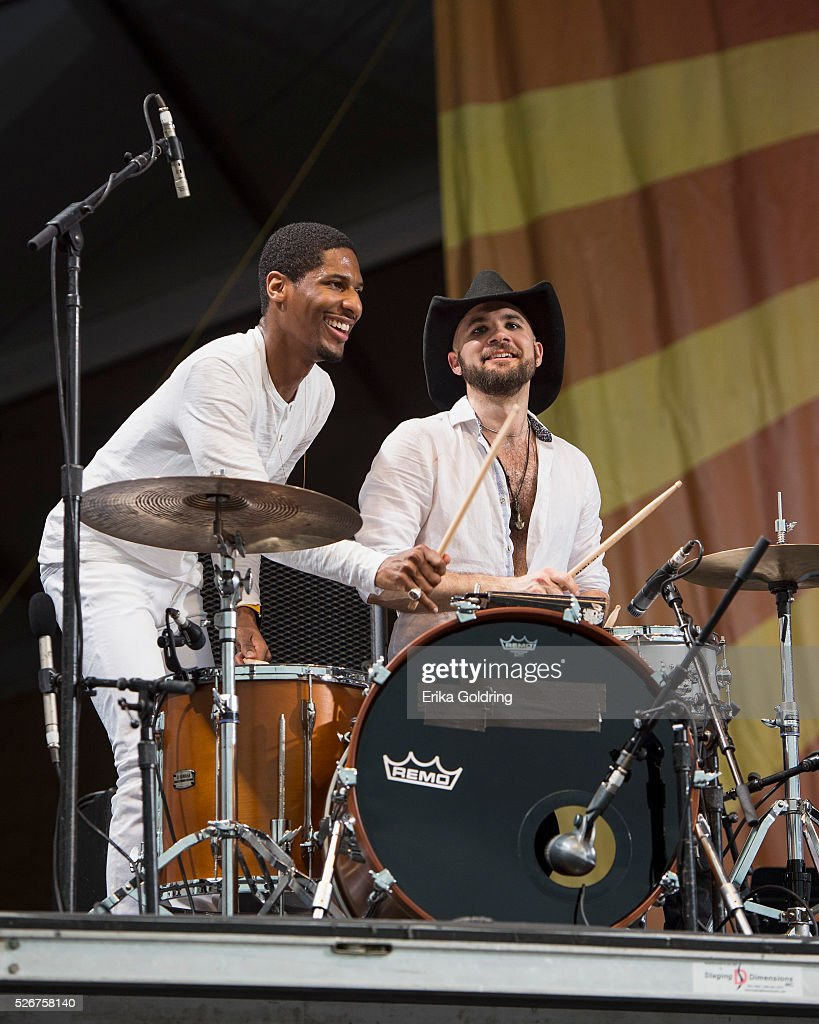 Jon Batiste and Joe Saylor perform at Fair Grounds Race Course on April 30, 2016 in New Orleans, Louisiana.
