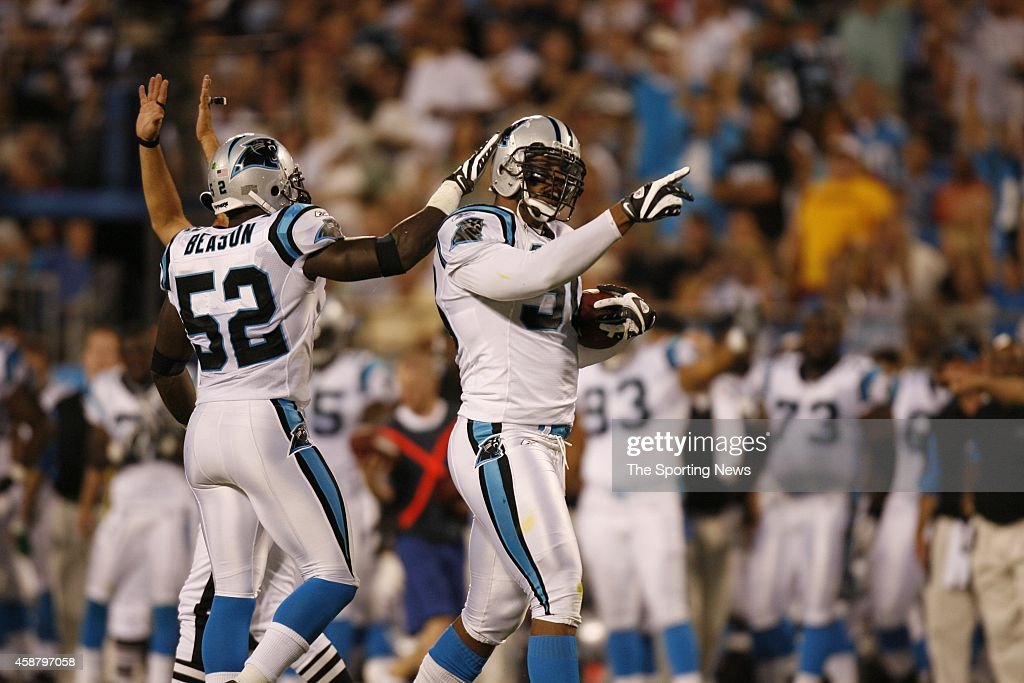 Jon Beason and Julius Peppers of the Carolina Panthers celebrate after the score during a game against the Washington Redskins on August 23 2008 at...
