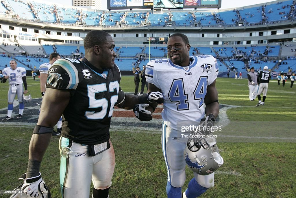 Jon Beason of the Carolina Panthers and Moran Norris of the Detroit Lions greet each other after a game on November 16 2008 at the Bank of America...
