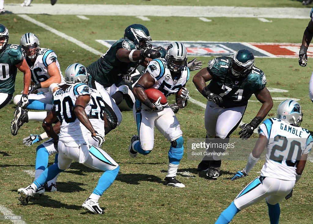 Jon Beason #52 of the Carolina Panthers returns an interception against the Philadelphia Eagles at Bank Of America Stadium on September 13, 2009 in Charlotte, North Carolina.