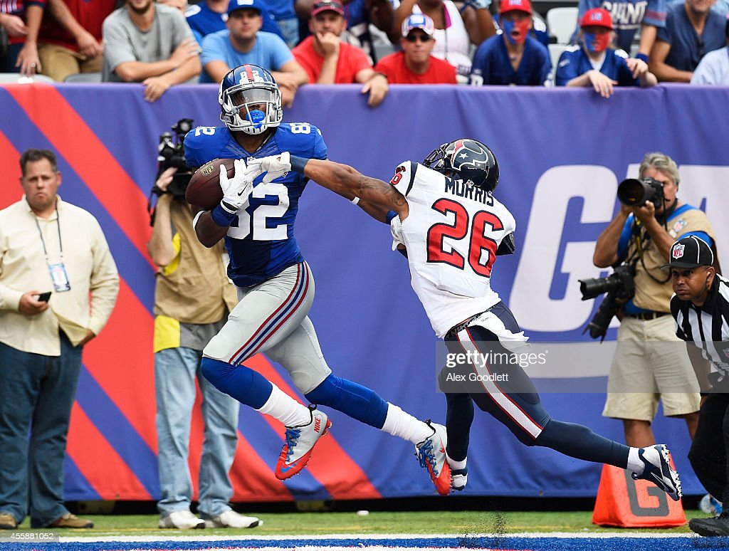 Jon Beason of the New York Giants fails to complete a pass as Darryl Morris of the Houston Texans defends in the fourth quarter at MetLife Stadium on...
