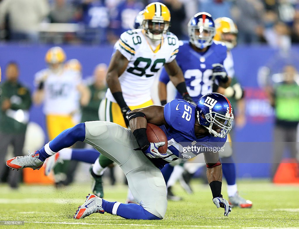 Jon Beason of the New York Giants intercepts a pass from Scott Tolzien of the Green Bay Packers at MetLife Stadium on November 17 2013 in East...