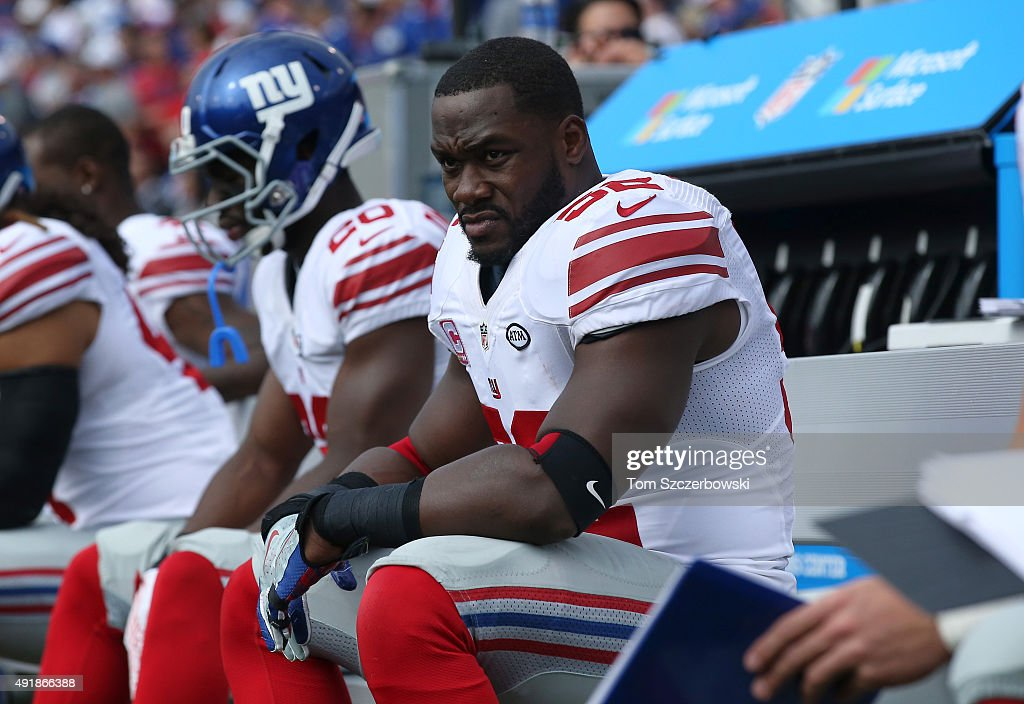 Jon Beason #52 of the New York Giants looks on from the bench during NFL game action against the Buffalo Bills at Ralph Wilson Stadium on October 4, 2015 in Orchard Park, New York.