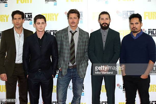 Jon Bernthal Logan Lerman Brad Pitt Shia LeBeouf and Michael Pena attend a photocall for 'Fury' during the 58th BFI London Film Festival at Corinthia...