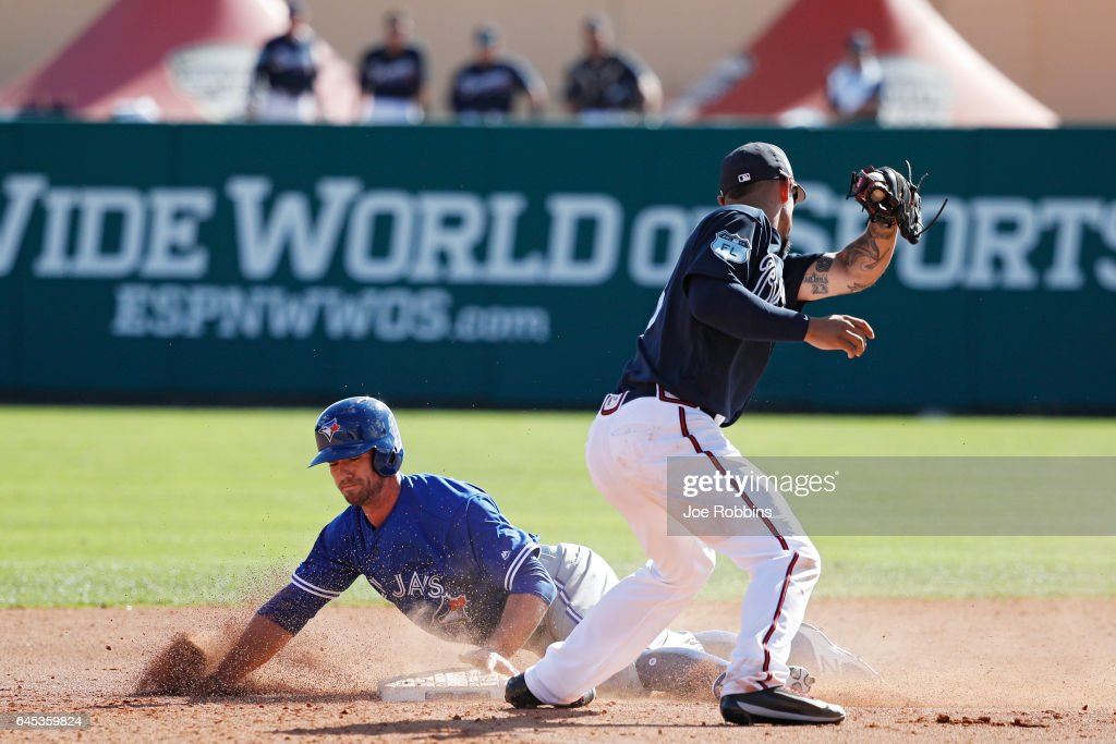 Jon Berti #60 of the Toronto Blue Jays steals second base in the fourth inning during the spring training game at Champion Stadium on February 25, 2017 in Lake Buena Vista, Florida. The Braves defeated the Blue Jays 7-4.