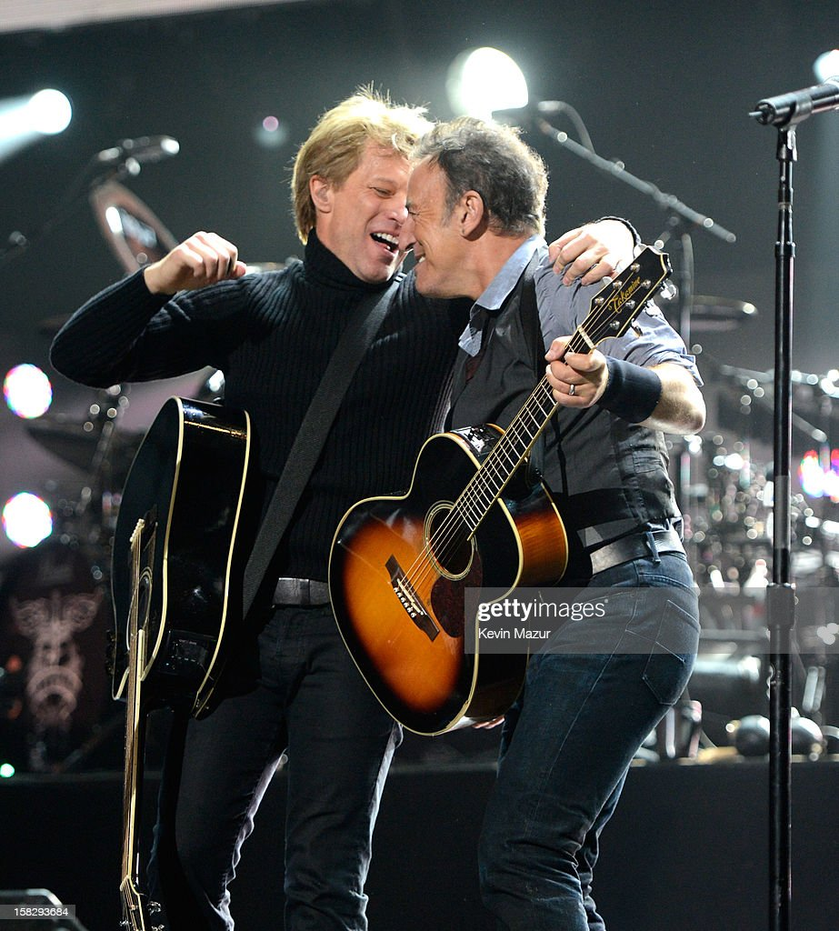 Jon Bon Jovi and Bruce Springsteen perform at '12-12-12' a concert benefiting The Robin Hood Relief Fund to aid the victims of Hurricane Sandy presented by Clear Channel Media & Entertainment, The Madison Square Garden Company and The Weinstein Company at Madison Square Garden on December 12, 2012 in New York City.