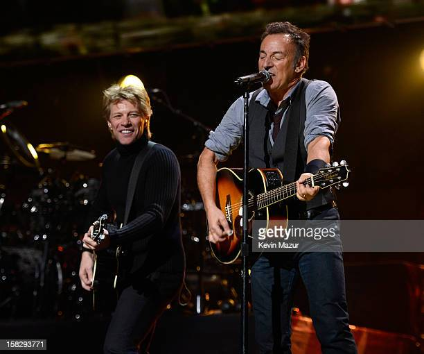Jon Bon Jovi and Bruce Springsteen perform at '121212' a concert benefiting The Robin Hood Relief Fund to aid the victims of Hurricane Sandy...
