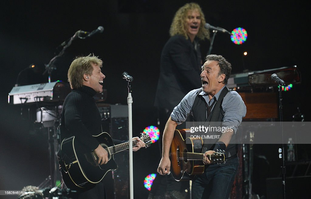 Jon Bon Jovi (L) and Bruce Springsteen (R) perform during '12-12-12 ~ The Concert For Sandy Relief' December 12, 2012 at Madison Square Garden in New York.