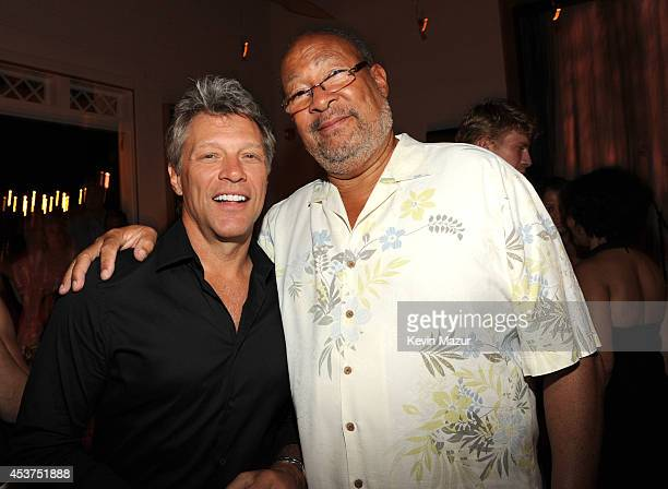 Jon Bon Jovi and Dick Parsons attend Apollo in the Hamptons at The Creeks on August 16 2014 in East Hampton New York