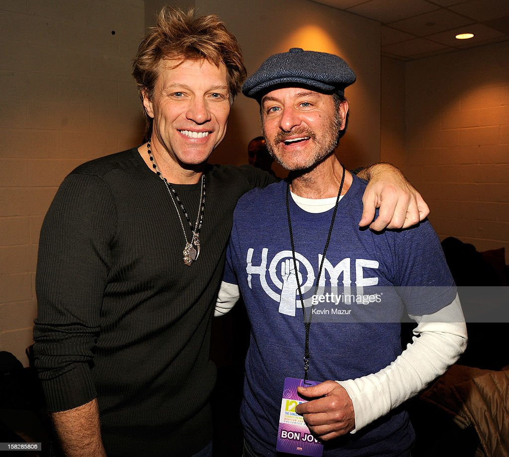<a gi-track='captionPersonalityLinkClicked' href=/galleries/search?phrase=Jon+Bon+Jovi&family=editorial&specificpeople=201527 ng-click='$event.stopPropagation()'>Jon Bon Jovi</a> and <a gi-track='captionPersonalityLinkClicked' href=/galleries/search?phrase=Fisher+Stevens&family=editorial&specificpeople=206958 ng-click='$event.stopPropagation()'>Fisher Stevens</a> backstage during '12-12-12' a concert benefiting The Robin Hood Relief Fund to aid the victims of Hurricane Sandy presented by Clear Channel Media & Entertainment, The Madison Square Garden Company and The Weinstein Company>> at Madison Square Garden on December 12, 2012 in New York City.