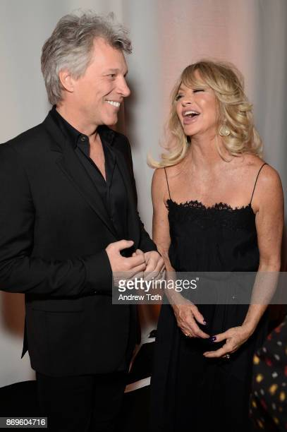 Jon Bon Jovi and Goldie Hawn laugh backstage at the Samsung annual charity gala 2017 at Skylight Clarkson Sq on November 2 2017 in New York City