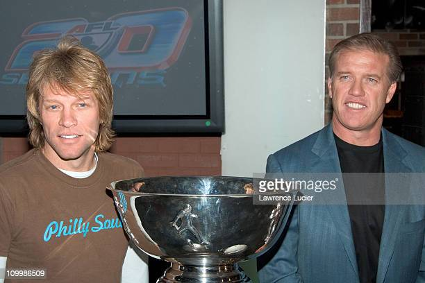Jon Bon Jovi and John Elway during Arena Football League's 20th Season Kickoff Press Conference at ESPN Zone in New York City New York United States