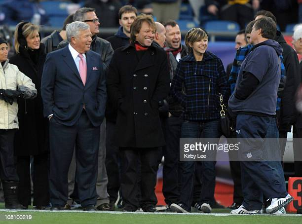 Jon Bon Jovi and New England Patriots owner Robert Kraft talk with Patriots coach Bill Belichick at the AFC Divisional Playoff game against the Newe...