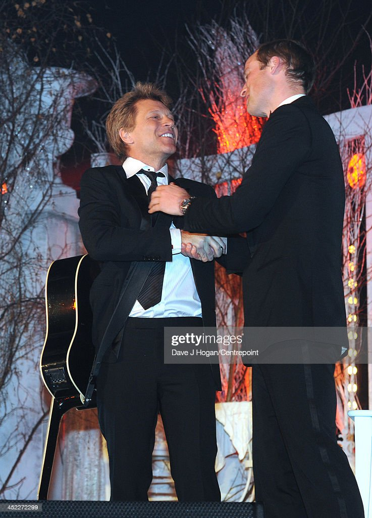 Jon Bon Jovi and Prince William, Duke of Cambridge congratulate each other on stage during the Winter Whites Gala In Aid Of Centrepoint on November 26, 2013 in London, England.