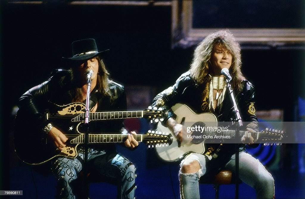 Jon Bon Jovi and Richie Sambora perform an acoustic version of 'Wanted Dead Or Alive' at the 6th Annual MTV Video Music Awards at the Universal Amphitheatre on September 6 1989 in Los Angeles, California.