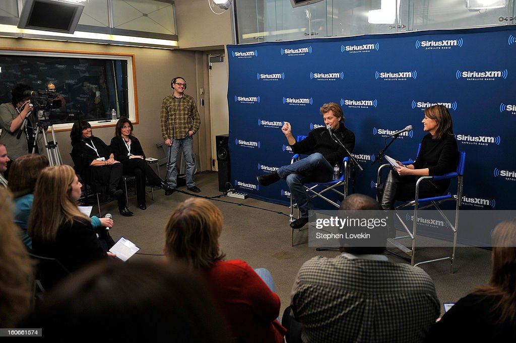 Jon Bon Jovi and Savannah Guthrie attend 'SiriusXM's Town Hall with Jon Bon Jovi' and moderator Savannah Guthrie at the SiriusXM studios on February 4, 2013 in New York City.