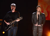 Jon Bon Jovi and Will Forte perform on stage at Comedy Central Night Of Too Many Stars at Beacon Theatre on February 28 2015 in New York City