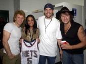 Jon Bon Jovi Jason Kidd point guard for the New Jersey Nets wife Joumana Kidd and Richie Sambora Joumana Kidd is holding Jason Kidd's New Jersey Nets...