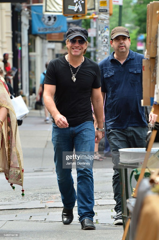 <a gi-track='captionPersonalityLinkClicked' href=/galleries/search?phrase=Jon+Bon+Jovi&family=editorial&specificpeople=201527 ng-click='$event.stopPropagation()'>Jon Bon Jovi</a> leaves the SoHo Grand after having lunch with Tim Tebow on May 27, 2012 in New York City.