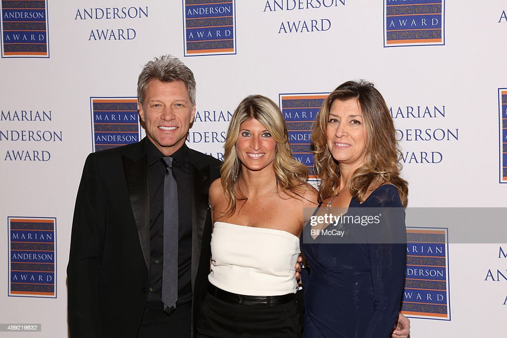 <a gi-track='captionPersonalityLinkClicked' href=/galleries/search?phrase=Jon+Bon+Jovi&family=editorial&specificpeople=201527 ng-click='$event.stopPropagation()'>Jon Bon Jovi</a>, Nina Tinari, board chair of the Marian Anderson Award and <a gi-track='captionPersonalityLinkClicked' href=/galleries/search?phrase=Dorothea+Bon+Jovi&family=editorial&specificpeople=3212467 ng-click='$event.stopPropagation()'>Dorothea Bon Jovi</a> attend the 2014 Marian Anderson Awards Gala Honoring <a gi-track='captionPersonalityLinkClicked' href=/galleries/search?phrase=Jon+Bon+Jovi&family=editorial&specificpeople=201527 ng-click='$event.stopPropagation()'>Jon Bon Jovi</a> at the Kimmel Center for the Performing Arts November 18, 2014 in Philadelphia, Pennsylvania.