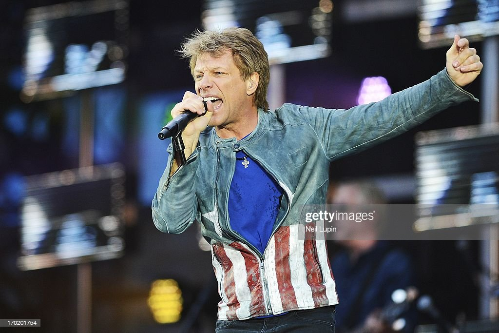 <a gi-track='captionPersonalityLinkClicked' href=/galleries/search?phrase=Jon+Bon+Jovi&family=editorial&specificpeople=201527 ng-click='$event.stopPropagation()'>Jon Bon Jovi</a> of Bon Jovi performs on stage on the opening night of the 'Because We Can' UK Tour at Etihad Stadium on June 8, 2013 in Manchester, England.