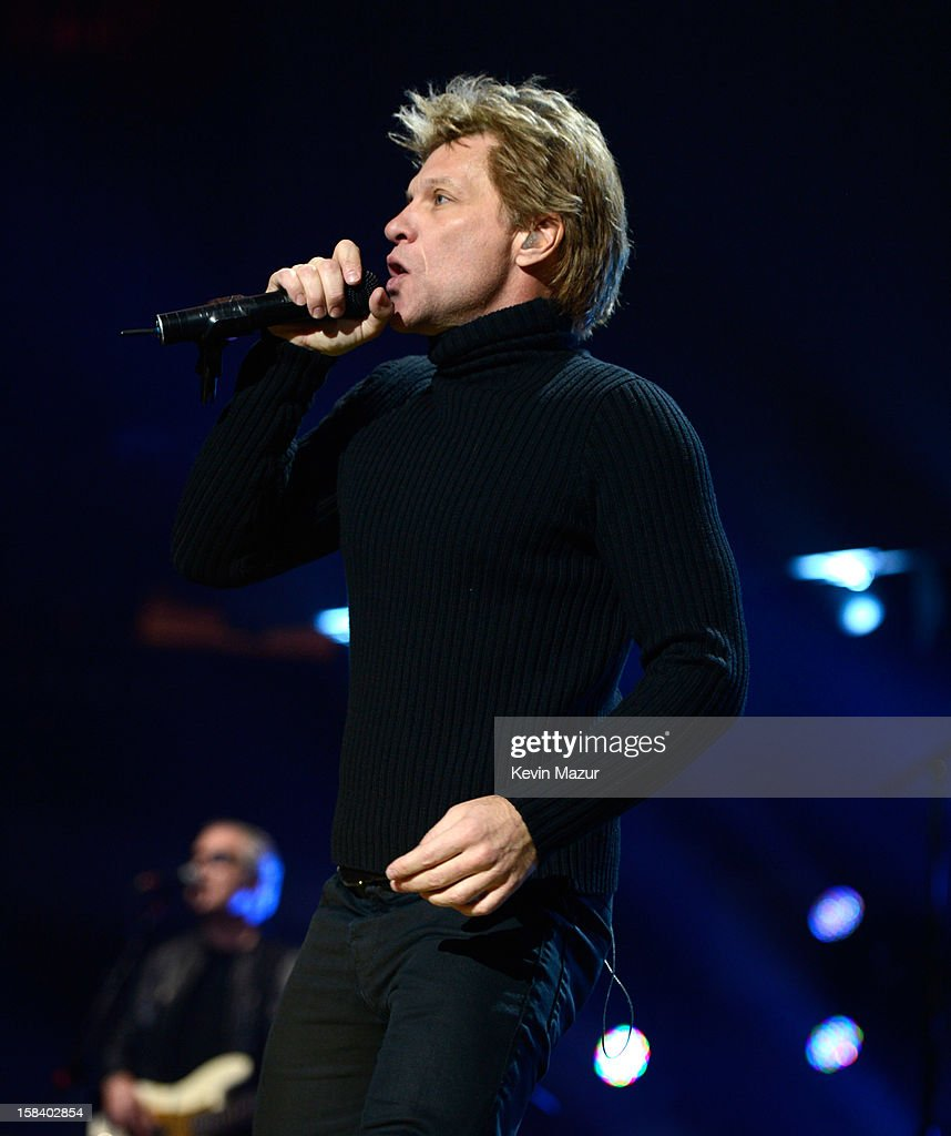 Jon Bon Jovi performs at '12-12-12' a concert benefiting The Robin Hood Relief Fund to aid the victims of Hurricane Sandy presented by Clear Channel Media & Entertainment, The Madison Square Garden Company and The Weinstein Company at Madison Square Garden on December 12, 2012 in New York City.