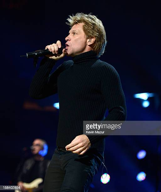 Jon Bon Jovi performs at '121212' a concert benefiting The Robin Hood Relief Fund to aid the victims of Hurricane Sandy presented by Clear Channel...