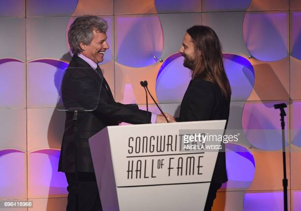 Jon Bon Jovi presents inductee Max Martin with his award onstage at the Songwriters Hall Of Fame 48th Annual Induction and Awards at New York...