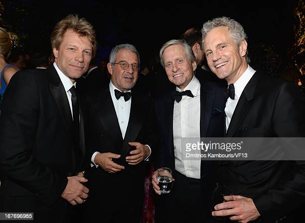Jon Bon Jovi Ron Meyers Michael Douglass and John Sykes attends the Bloomberg Vanity Fair cocktail reception following the 2013 WHCA Dinner at the...