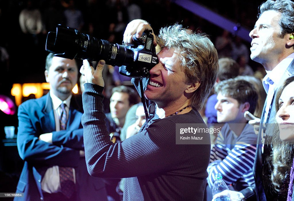 <a gi-track='captionPersonalityLinkClicked' href=/galleries/search?phrase=Jon+Bon+Jovi&family=editorial&specificpeople=201527 ng-click='$event.stopPropagation()'>Jon Bon Jovi</a> takes photo during '12-12-12' a concert benefiting The Robin Hood Relief Fund to aid the victims of Hurricane Sandy presented by Clear Channel Media & Entertainment, The Madison Square Garden Company and The Weinstein Company>> at Madison Square Garden on December 12, 2012 in New York City.