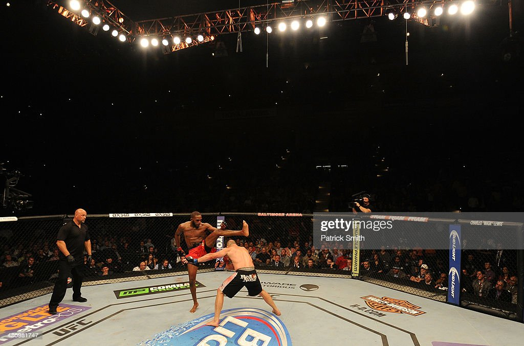 Jon 'Bones' Jones kicks Glover Teixeira in their light heavyweight championship bout during the UFC 172 event at the Baltimore Arena on April 26, 2014 in Baltimore, Maryland.