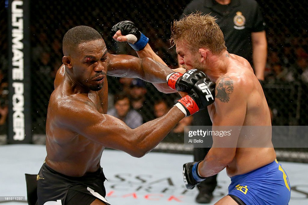 Jon 'Bones' Jones punches Alexander Gustafsson in their UFC light heavyweight championship bout at the Air Canada Center on September 21, 2013 in Toronto, Ontario, Canada.