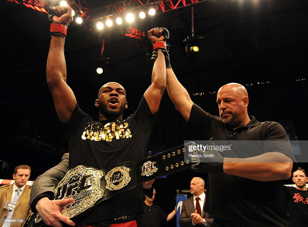 Jon 'Bones' Jones reacts after defeating Glover Teixeira in their light heavyweight championship bout during the UFC 172 event at the Baltimore Arena on April 26, 2014 in Baltimore, Maryland.
