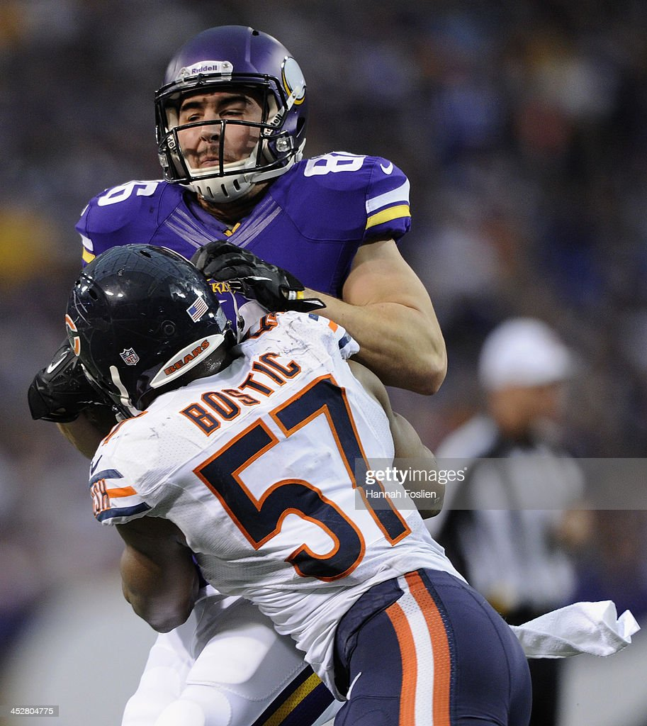 <a gi-track='captionPersonalityLinkClicked' href=/galleries/search?phrase=Jon+Bostic&family=editorial&specificpeople=8537426 ng-click='$event.stopPropagation()'>Jon Bostic</a> #57 of the Chicago Bears tackles Chase Ford #86 of the Minnesota Vikings during the fourth quarter of the game on December 1, 2013 at Mall of America Field at the Hubert H. Humphrey Metrodome in Minneapolis, Minnesota. The Vikings defeated the Bear 23-20 in overtime.