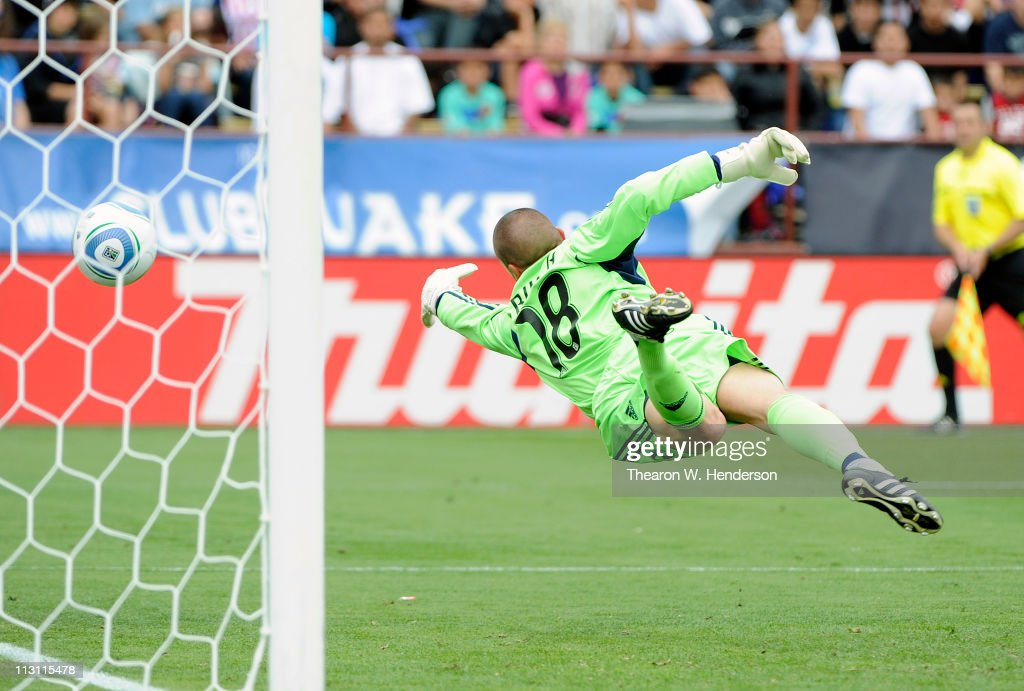 Jon Busch of the San Jose Earthquakes dives at this wide shot against Chavis USA during an MLS soccer game at Buck Shaw Stadium on April 23 2011 in...