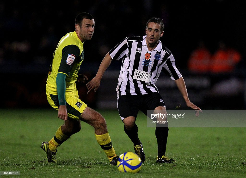Jon Choprena-Garcia of Dorchester Town wins the ball from Jamie Lowry of Plymouth Argyle during the FA Cup with Budweiser 1st Round match between Dorchester Town and Plymouth Argyle at The Avenue Stadium on November 4, 2012 in Dorchester, England.