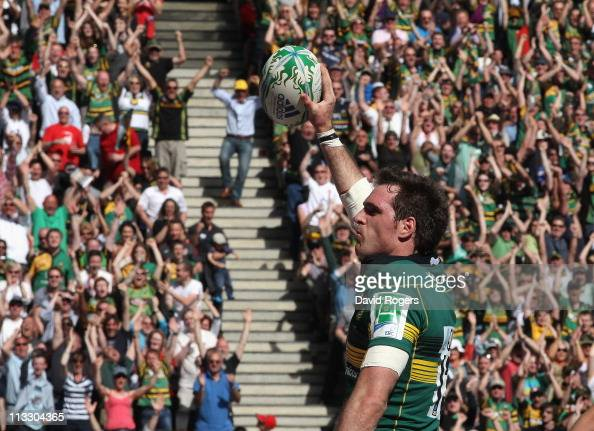 Jon Clarke of Northampton celebrates after scoring the Saints second try during the Heineken Cup semi final match between Northampton Saints and...
